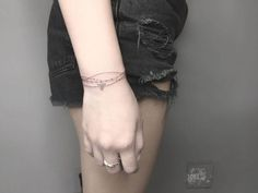 bracelet tattoo on wrist