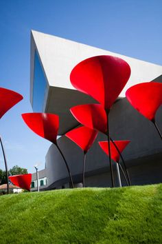 This clean and simple modern architecture has a bit of a Christo feel to it, maybe that's just the giant red poppies.