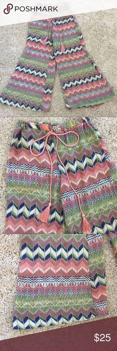 Multicolored chevron flare pants Multicolored chevron flare pants with pink rope tie detail. 40 inches in length. Stretchy waist band xtaren Pants