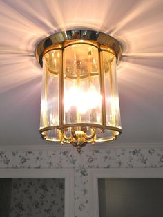 Another classic brass and glass light fixture.