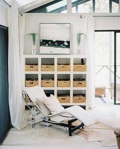 White bookcase with baskets to hide mail, magazines, toys, coupons, etc. (Lonny Magazine June/July 2012 design and decoration de casas interior decorators design bedrooms