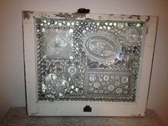 Repurposed old window using glass dishes and pieces