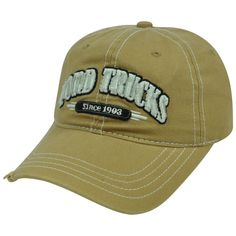 Ford Trucks on a distressed tan, new ball cap, with tags: Ford Pick up Trucks on a tan distressed new ball cap.  Front and black embroidery, as well as a velchro strap on the rear of the cap.  Just 2 left..buy now