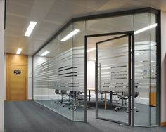 SAS International's System 8000 fully-glazed, frameless partitioning system combines aesthetics with outstanding acoustic, fire and structural performance.