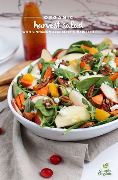 This fresh, hearty organic harvest salad recipe includes sweet potatoes, butternut squash and pears all topped off with a sweet cinnamon cranberry vinaigrette.