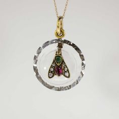 Rare 1860's Ruby Emerald Rose Cut Diamond Rock Crystal Insect Pendant 14k | Price $1450.00 Antique & Estate Jewelry | Jewelry Finds  What a cool and unusual pendant from the 1860's! Six glittering rose cut diamonds, a pear-shaped natural ruby and an antique cushion-shaped emerald are set in yellow gold on top of a natural faceted rock crystal and is truly a one-of- a-kind find!