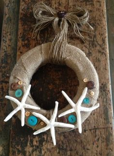 LOVE the Christmas Seaside Wreath with Sculpey Premo Polymer Clay uses #buttonsgalore #polymerclay Teal white and brown