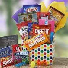 """""""Movie gift kit. Buy a gift box and put in the following: A DVD (or a rental voucher if money is tight), a packet of popcorn, a mini tub of Pringles, a mini can of drink, some chocolate, and make up your gift tag to look like a movie stub."""""""