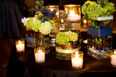 #green and #blue #centerpieces on top of a lovely #chocolate satin tablecloth. #weddings
