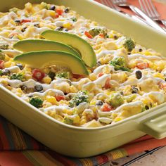 One-Dish Fiesta Casserole | Meals.com -  The flavors from South-of-the-Border come together in this zesty bake. Right before serving, top with a dollop of sour cream and fresh avocado slices for a little extra festivity. #comfortfood #onedish