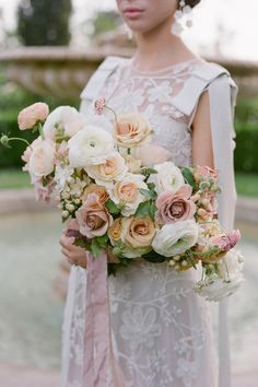 """From the editorial """"An All-Star Team of Vendors Came Together to Create Pastel Magic at Greystone Mansion"""". @wilderfloralco graced the day with feminine and sweet blooms. @detailedtouchevents says, """"We infused the pastel color palette into all of the design details from the opulent stationery produced by Yonder Design to the artistic cake created by Jasmine Rae Cakes."""" LBB Photography: @josevilla #stylemepretty #weddingdress #weddingbouquet #bouquet #weddingflowers Wedding Reception Flowers, Spring Wedding Flowers, Wedding Flower Arrangements, Wedding Bridesmaid Bouquets, Wedding Dresses, Wedding Shoot, Dream Wedding, Wedding Stuff, Wedding Ideas"""