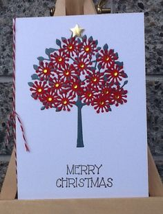 My 2013 Christmas card. The Pohutukawa tree is known as the New Zealand Christmas tree because of its dark green glossy leaves and stunning red flowers that cover the tree in summer, which is Christmas-time in NZ.