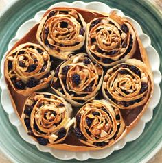 the traditional pitta 'mpigliata, baked pastry rosettes filled with walnuts, almonds, raisins, cinnamon and drizzled with honey