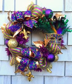 Its Mardi Gras season! Celebrate New Orleans style with this deluxe Mardi Gras Wreath! Made on a evergreen wire base form, this wreath