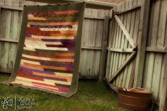 Jelly Roll Race Quilt Finished by MagnoliaFly, via Flickr