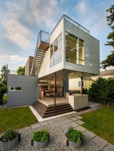 Wonderful Backyard Exterior With Gray And White Walls Also Staircase Towards The Roof Top Along With Concrete Patio And Green Courtyard Decorated By Green Plants And Concrete Path Modern House in Seattle with Unusual Shapes Home design