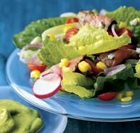 Skirt Steak Salad with Poblano-Avocado Dressing  Warm, seasoned beef complements a crisp green salad drizzled with a creamy, poblano-spiked dressing. For a delicious lunch to go, spread a whole-wheat tortilla with dressing, layer the remaining ingredients, and roll.