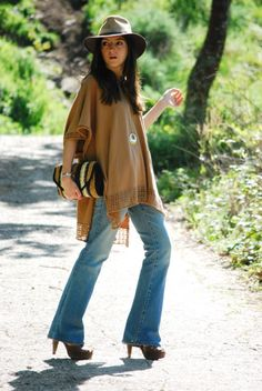 Poncho by H&M, flared pants by Pull & Bear, clutch and sandals by Sfera. (lovely-pepa.com, April 4, 2011)