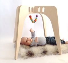 A modern, sleek all wood take on the classic baby gym. Finished with 100% natural, non-toxic stains and waxes. 8 spots to hang your baby's...