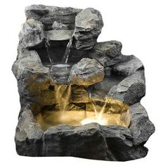 Electric cascading water fountain with a stone-inspired design. Suitable for indoor or outdoor use.