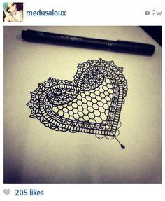 Intricate lace heart tattoo design