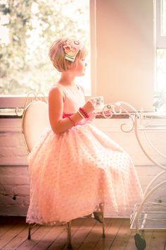 https://www.facebook.com/tuxedoteacup  Custom wedding or party dresses.  For more info - send an e-mail to tuxedoteacup@gmail.com