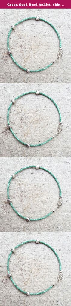 Green Seed Bead Anklet, thin anklet, small beaded anklet, simple minimal anklet. Beaded Anklet with glossy green glass seed beads and brass-finished findings on thin metal wire with 3 metal silver-colored heart beads. The anklet can be taken on and off with a brass-finished lobster clasp. I am more than happy to do custom orders and provide discounts on larger orders. Let me know if you have any questions! Your anklet will arrive in a small colorful fabric bag with hemp ribbon, ready as a...
