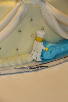 Lego chef constructing wedding cake. I so badly want to hide a geeky thing in our cake.