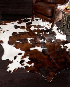 Cowhide rug on natural floor