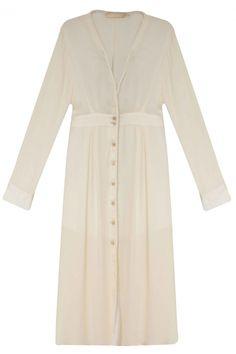 VESTIDO CALA Vestido godê, comprimento midi, decote V com detalhe trançado, manga longa, punho fechado em botões e fechamento frontal em botões adornados.