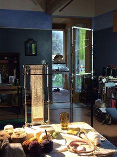 Sarah Swett's tapestry studio with galvanized pipe looms