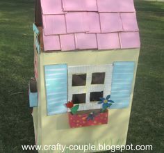 Painted cardboard house for kids...summer fun.