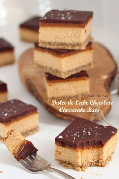 Dulce de leche chocolate cheesecake bars from Roxanashomebaking... Rich creamy caramel-y cheesecake topped with a thin layer of dulce de leche and chocolate ganache and a sprinkle of fleur de sel. The perfect sweet and salty treat!