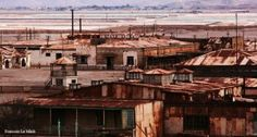 Humberstone and Santa Laura Saltpeter Works are two former saltpeter refineries located in northern Chile abandoned in 1960 Abandoned Cities, Tourist Sites, Cheap Hotels, Hotel Deals, Ghost Towns, Luxury Travel, South America, Paris Skyline, Travel Destinations