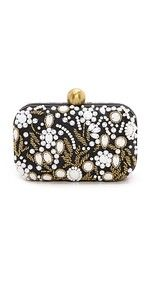 Gold tone seed beads add intricate sparkle to this satin clad Santi box clutch. A kiss lock clasp opens the hinged frame. Satin lining. White Clutch, White Handbag, Beaded Clutch, Beaded Purses, Designer Clutch, Designer Bags, White Purses, White Beads, Pearl Beads