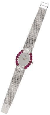 A ruby and diamond wristwatch, by Chopard #christiesjewels #watch