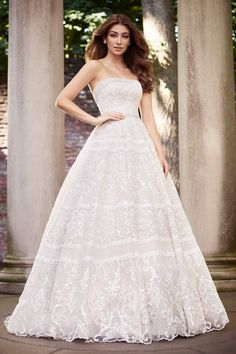 A sparkling work of art, this dynamic ball gown takes couture to a whole new level. Allover embroidered Schiffli lace glitters throughout with clear sequins. Encrusted beading at the dramatic curved strapless. Designer Wedding Dresses, Bridal Dresses, Wedding Bride, Wedding Gowns, Wedding Bells, Wedding Stuff, Dream Wedding, Wedding Ideas, Mon Cheri Bridal