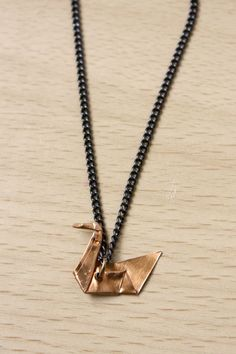 Use thin metal sheet to make your own origami swan necklace!