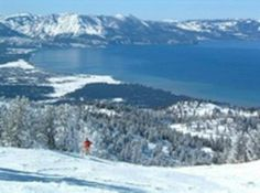 Beautiful alpine Lake Tahoe.  It is 12 miles wide and 25 miles around, has an avg. depth of 989 ft. and 1645 ft. deep at it's maximum   (small submarines have explored it) and it is patrolled by the U.S. Coast Guard.  It is divided slightly off the center by two states - Calif. & Nevada.  You can swim from state to state!