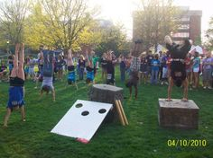 Circus performers having a handstand contest on the quad