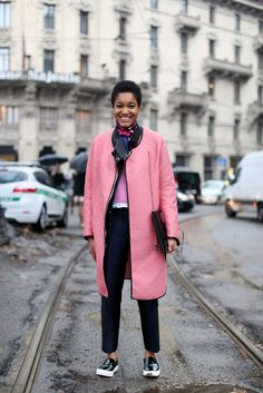 Tamu McPherson layers her pinks. Meanwhile, a neckerchief is turning out to be a huge trend for spring. #refinery29 http://www.refinery29.com/milan-fashion-week#slide-20