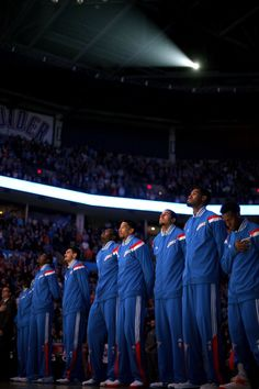 The Thunder stands during the national anthem before an NBA basketball game between the Oklahoma City Thunder and the Washington Wizards at Chesapeake Energy Arena in Oklahoma City, Friday, Jan. 2, 2015. Photo by Bryan Terry, The Oklahoman