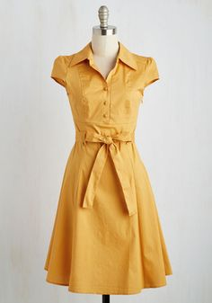 In this '50s-inspired shirtdress, your date at the ice cream parlor is a stylish one! The bright goldenrod hue, fabric-covered buttons, and slight stretch to the cotton blend of this eye-catching dress make it a cute wear in which you share a yummy float! Find this fun design in a host of other haute hues!