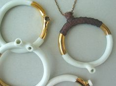 rian de jong   necklaces in ceramic, copper, and gold leaf