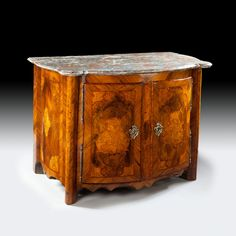 AN EARLY 18th CENTURY MARQUETRY CABINET : Nicholas Wells Antiques A fine early 18th century two door marquetry cabinet, retaining the original mottled marble top and veneered throughout in fine and highly figured woods of walnut, burr elm and kingwood.