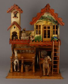 Wonderful two story stable with 'gingerbread' trim, hand painted walls, and a ladder to the living quarters above.  No other information found, re: date, size, or origin.