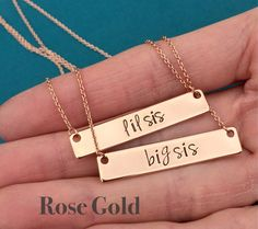 Set of 2 lil sis & big sis Necklaces / Rose Gold Bar Necklace / Sister Gift Font shown is Jenna Sue  The bar/pendant is 16k rose gold plated brass and is 1.35 long x 0.28 wide The chain is also 16k rose gold plated brass Read further down for more information on rose gold plated brass  --------------------HOW TO ORDER----------------------  Add the necklaces to your cart with the chain length that youd like selected from the drop down menu.  *The stamping WILL be blackened ...