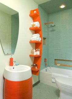 green and orange bath with vola fixtures, Mary Anne Smiley via Atticmag