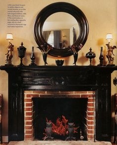 glossly black fireplace, red, AND great wall color. Painted Mantle, Black Fireplace, Fireplace Brick, Fireplace Mantles, Fireplace Ideas, Indian Tapestry, Hearth And Home, Gothic House, Hallows Eve