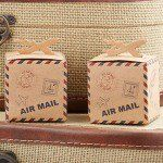 """""""Around the World"""" map favor boxes are the perfect wedding accessory for the travel enthusiast couple."""